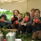 Children taking part in a bushcraft workshop at Kilruddery
