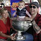 East Coast's Laura Wood with Robbie Doyle, his daughter Nahla Beau and the Sam Maguire Cup at the Martello.