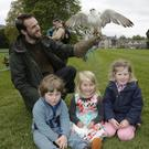 Stephen McCann of Newgrange Falconry with a Saker Falcon and Michéal McSweeney, Sophie Schriever and Ellarose McSweeney