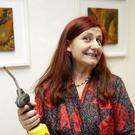 Isabelle Gaborit giving an encaustic demonstration before the opening of her exhibition at Signal Arts Centre.