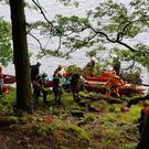 The mountain rescue teams delivering the casualty to Greystones Coast Guard at Lough Dan on Sunday