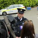 Superintendent Pat Ward speaking to a reporter near Glenmacnass waterfall