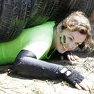 Sheila Morris squeezes under the first set of tyres