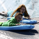 Abbey Keating and Derek Murphy clearly enjoying the slide at the Clash Fest family fun day on Sunday, June 25