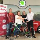 Mary Coleman from Bray and her son Ben (left) are presented with their bikes by Donna Murphy from the Wicklow People and Bray People and Stephen Healy, General Manager at Sinnott Autos last Friday