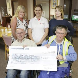 Mia Shepherd from the Hospital Saturday Fund (right,back) presenting the cheque to Suzanne Cox, Ronan Carroll, Justyna Oleksiewicz and Jimmy Hayes from Open Door