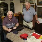 John Mahon presents artefacts to Danny O'Neill, Chairman of Arklow Maritime Museum