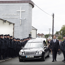 Gardaí members form a Guard of Honour at David Hannon's funeral