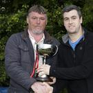 John Murphy presents the cup in the memory of son Thomas to the captain of The Bhoys, Graham Devlin
