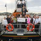 The Hughes family presenting a cheque for €7,520 to Arklow RNLI