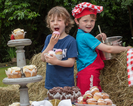 Brothers Arlo and Sebastian Byrne try their hand at mixing up a batch of buns ahead of this Sunday's Enniskerry Field Day