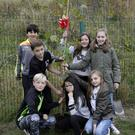 Ned Bolger, Euan McEvoy, Isaam Hussain, Amelia Pullen, Anna Weldon, Lissey McEvoy and Paige Tomlin, fifth and sixth class students who were in the old school, plant the birch tree