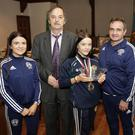 Coach Eve Carr, Cllr Oliver O'Brien, Daina Moorehouse, Paul O'Toole, head coach, and Eamonn Carr, secretary of Enniskerry Boxing Club, at the presentation to Daina at last week's meeting of Bray Municipal District