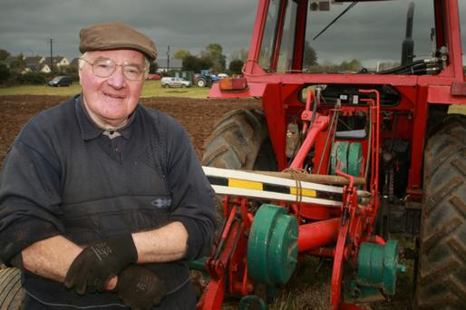 The late John Donnelly at the Carnew ploughing championship recently, where the champion ploughman was competing in the two furrow class.