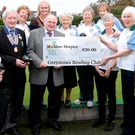 Members of Greystones Bowling Club present a cheque to Wicklow Hospice Foundation