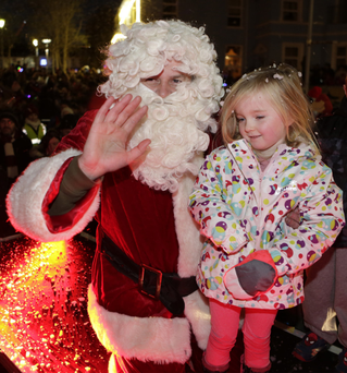 Santa with Isabel Gilmore-Mravinac, who switched on the Bray lights