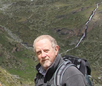 Author Michael Fewer trekking through County Wicklow