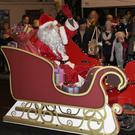 Santa Claus arrives in his sleigh on Sunday evening