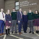 Megan Healy, Josh Shekleton, Hannah Hicks, Vice Principal Simon Carey, Lucy Smoulter-Dolan, Dylan Smith, Minister Simon Harris, Principal Mary O'Doherty, Ian Anderson, Aisha Ryan and Joshua Galligan at St David's Holy Faith Secondary School.