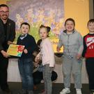 Caomhán Mac Con Iomaire from the National Gallery of Ireland making a presentation to Darragh Healy, Eva Young, Simon D'Arcy and Sam Tallant from Marino Community School in Bray.