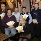Cllr Tom Fortune,Dessie O'Toole, John Duggan, Collette Ghith from Living Life Counselling, Garda James Reynolds and Garda Brian Saunders with the leaflets