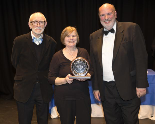 Adjudicator Terry Byrne and festival director William Mansefield presenting the Adjudicator's Award to Hilda Roche from Ashford ICA