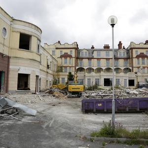 An application lodged in November to totally demolish the former La Touche Hotel has been withdrawn