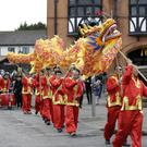 The dragon passes by Bray Town Hall.