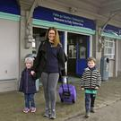 Melissa and Michael Dooley meet Tara Gretton (centre) at Bray Dart Station. Photo: Garry O'Neill