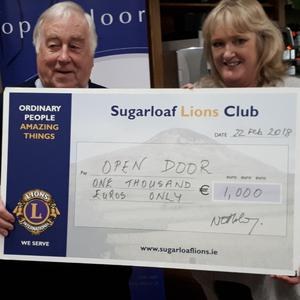 Gerry Treanor of Sugarloaf Lions and Suzanne Cox of Open Door.