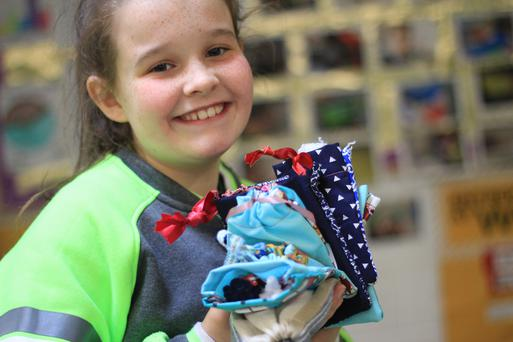 Emily Kelly admiring some 'Worry Friends' and hand-sewn bags.