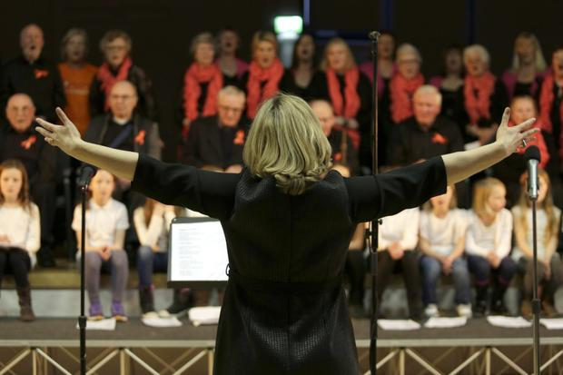 Dara McMahon gets all the choirs singing together for the grand finale at a previous Wicklow Sings Choral Festival.