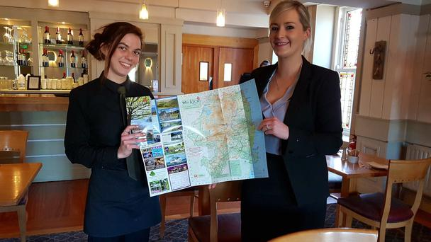 Suzy Quirke and Sarah Fortune from the Grand Hotel with the 2018 Tourism Map.