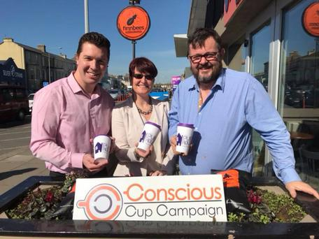 Conor O'Leary of Purple House, Gillian McGarry of Inspire Promotional Products and Paul Finnegan of Finnbees Coffee House with the Purple House reusable coffee cup.