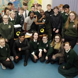 Murli Boevi and Godknows Jonas with the students in the music room during the Rusango Family rap workshop at St Kilians, facilitated by Music Generation Wicklow