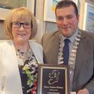 Cllr Tommy Annesley, cathaoirleach of Arklow Municipal District, presents Mary with a Special Recognition Award.