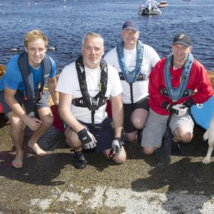 Fionn Crowley, John Hearns, Ronan Whelan, Alan Connolly and Ger Crowley with Joey the dog ahead of the Shannon by Oar challenge.