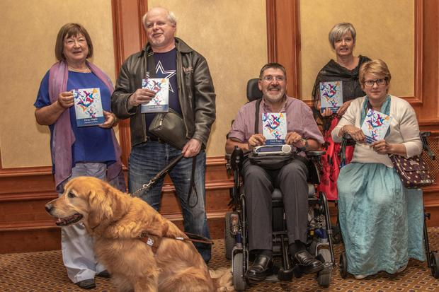Louise Wardell, Mark Talbot and Grogan his guide dog, Mark Mitchell, Carol Boland (facilitator) and Julia Harte at the launch of the Greystones Scribblers' first publication 'First Flight' in the Glenview Hotel