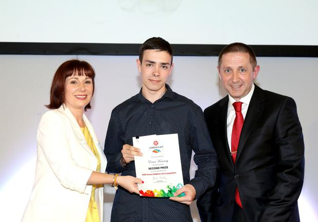 Evan Kearney receiving his prize from Minister Josepha Madigan and James Twohig, Director of Ireland Operations at Valero
