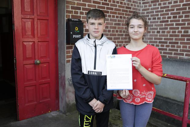 Wayne Nelson and Lucy Skye Dunne with one of the letters being sent by the students of North Wicklow Educate Together to Richard Bruton about their school premises