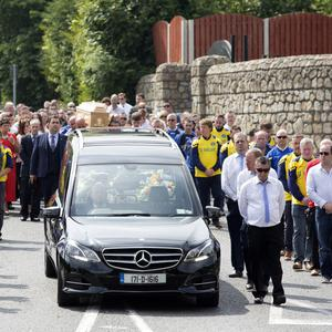 Glencormac Utd and Bray Wheelers providing a guard of honour as Bobby's remains are carried to the church