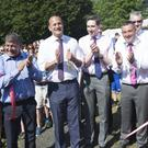 Minister Andrew Doyle, Taoiseach Leo Varadkar, Minister Simon Harris, Cllr Shay Cullen and Cllr Edward Timmins as the Taoiseach cuts the ribbon to open the walks
