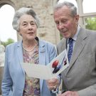 The Countess and Earl of Meath read a card from Bray Municipal District