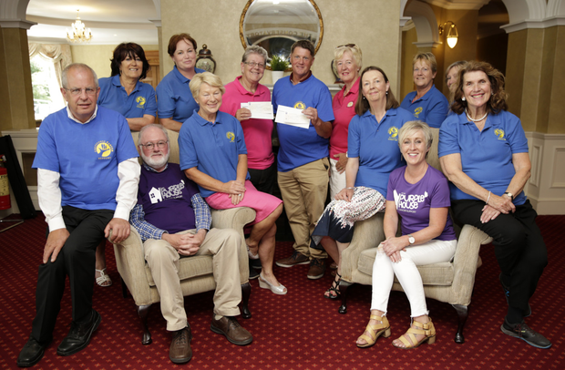 Mairéad O'Reilly, Joe Carroll and Gabrielle Lindsay Evans present the proceeds of the Glenmill Golf Club Pink Ladies Day to representatives of PurpleHouse and Greystones Cancer Support