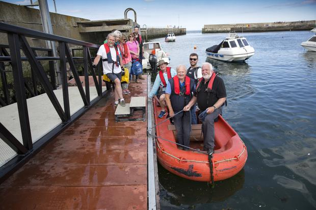 Bernard Tyner and Tony Foran from Bray Sailing Club making good use of the new pontoon at Bray Harbour with other sailing club members.