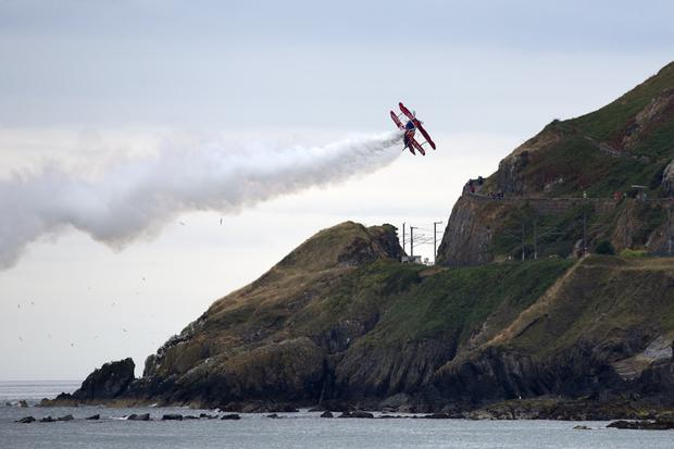 The G-EWIZ biplane comes in close to the cliff walk during the Bray Air Display on Sunday. Photos: Barbara Flynn