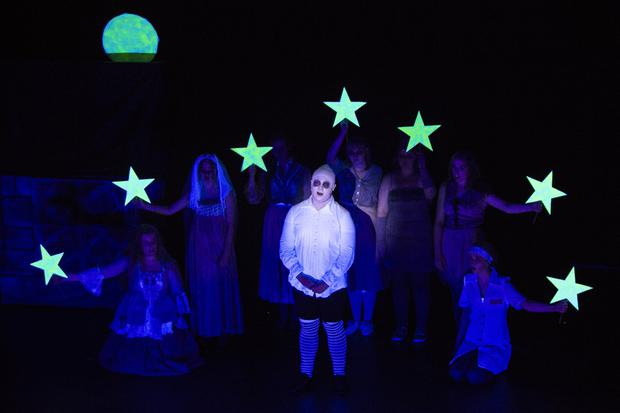 Uncle Fester (Conor Martin) sings to the moon during Sheevawn Musical Youth Theatre's production of The Addams Family: The Musical at the Mermaid Arts Centre. Photos: Barbara Flynn
