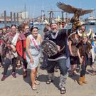 Colm Weadick and festival queen Katie Hawthorne leading the Vikings ashore for Sunday's raid at the RNLI Arklow Maritime Festival. Photos: Paul Messitt