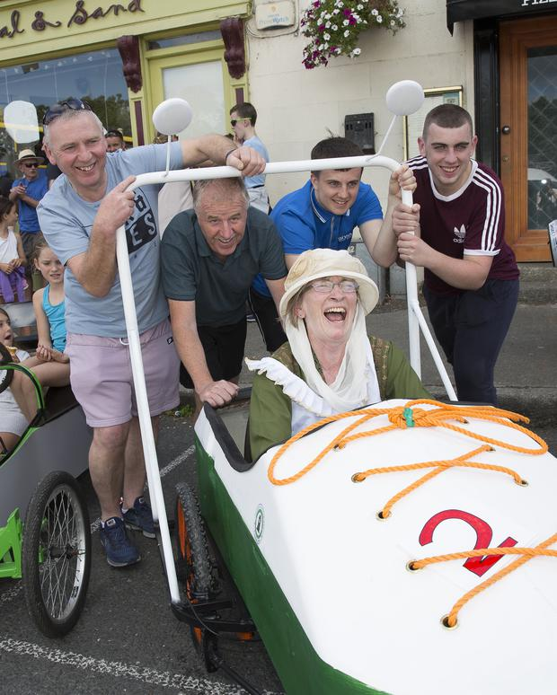 Jenny Bolger drives Enniskerry YC's Shoe pushed by Willy Acres, Dermot Mulligan, Karl Mulligan and Alan Acres.
