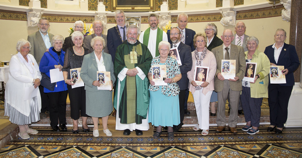 Monsignor Enda Lloyd, Fr John Daly PP and chairman of the Pioneer Association Matt Boylan celebrating 100 years of pioneers in the parish with the members who received silver, gold and diamond pins